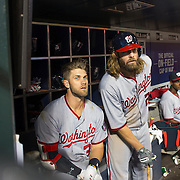 NEW YORK, NEW YORK - May 18:  Bryce Harper #34, (left), of the Washington Nationals and team mate Jayson Werth #28 of the Washington Nationals watch play from the dugout as they prepare to bat during the Washington Nationals Vs New York Mets regular season MLB game at Citi Field on May 18 2016 in New York City. (Photo by Tim Clayton/Corbis via Getty Images)
