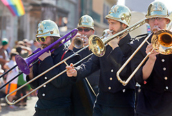 31 January 2016. New Orleans, Louisiana.<br /> Mardi Gras Dog Parade. Music accompanying the dance troupe Gris Gris Strut. The Mystic Krewe of Barkus winds its way around the French Quarter with dogs and their owners dressed up for this year's theme, 'From the Doghouse to the Whitehouse.' <br /> Photo©; Charlie Varley/varleypix.com