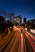 Car light trails along the Eastern Distributor photographed from Art Gallery Road, Sydney.