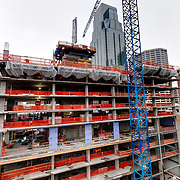 Construction progress (December 7th, 2014) on the One Light Tower at 13th & Walnut Streets, downtown Kansas City, Missouri. The first planned new-built residential component to the Cordish Company's Power and Light District. Humphreys and Partners Architects, Kushner Companies, co-developer. JE Dunn Construction, general contractor.