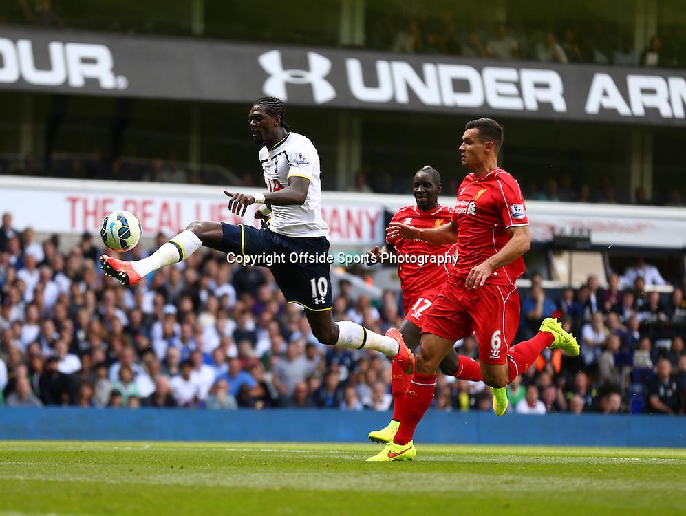 31 August 2014 - Barclays Premier League - Tottenham Hotspur v Liverpool - Emmanuel Adebayor of Tottenham Hotspur tries to lift the ball over Simon Mignolet of Liverpool - Photo: Marc Atkins / Offside.