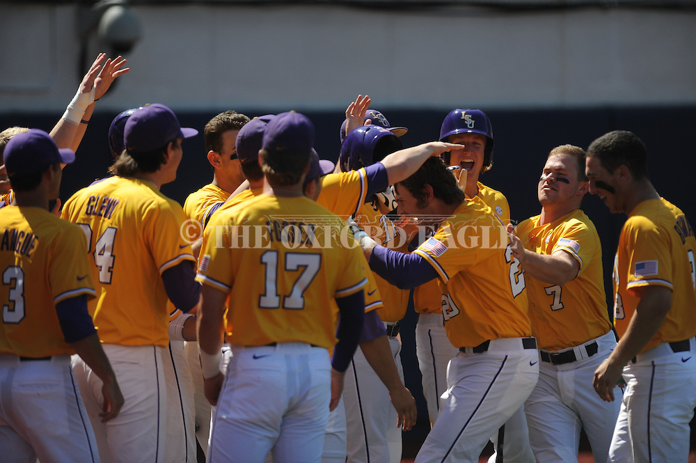 LSU's Conner Hale (20) is congratulated by teammates following his 8th inning solo home run against Mississippi at Oxford-University Stadium in Oxford, Miss. on Saturday, April 19, 2014. LSU won 2-0. (AP Photo/Oxford Eagle, Bruce Newman)
