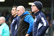 Port Vale Manager Neil Aspin  and his two Asssitants during the EFL Sky Bet League 2 match between Grimsby Town FC and Port Vale at Blundell Park, Grimsby, United Kingdom on 10 March 2018. Picture by Mick Atkins.