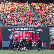 03 September 2016: The San Diego State Aztecs football team open's up the season at home against the University of New Hampshire Wildcats.  San Diego State quarterback Christian Chapman (10) scrambles for a first down in the second quarter. The Aztecs lead 21-0 at halftime. www.sdsuaztecphotos.com