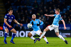 Kevin De Bruyne of Manchester City controls the ball under the watch of Sergio Aguero of Manchester City and Caglar Soyuncu of Leicester City - Mandatory by-line: Robbie Stephenson/JMP - 18/12/2018 - FOOTBALL - King Power Stadium - Leicester, England - Leicester City v Manchester City - Carabao Cup Quarter Finals