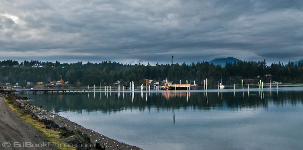 Construction proceeds on the marina at Seabeck, WA on Seabeck Bay of the Hood Canal of Puget Sound.  panorama