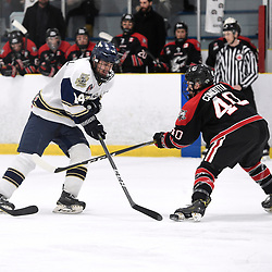 TORONTO, ON  - APR 10,  2018: Ontario Junior Hockey League, South West Conference Championship Series. Game seven of the best of seven series between Georgetown Raiders and the Toronto Patriots. Oliver Benwell #14 of the Toronto Patriots battles for the puck with Jaden Condotta #40 of the Georgetown Raiders during the first period.<br /> (Photo by Andy Corneau / OJHL Images)