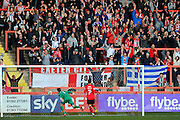 Exeter fans celebrate after Exeter City's Jayden Stockley gives the home team 1-0 lead during the Sky Bet League 2 match between Exeter City and Carlisle United at St James' Park, Exeter, England on 12 March 2016. Photo by Graham Hunt.