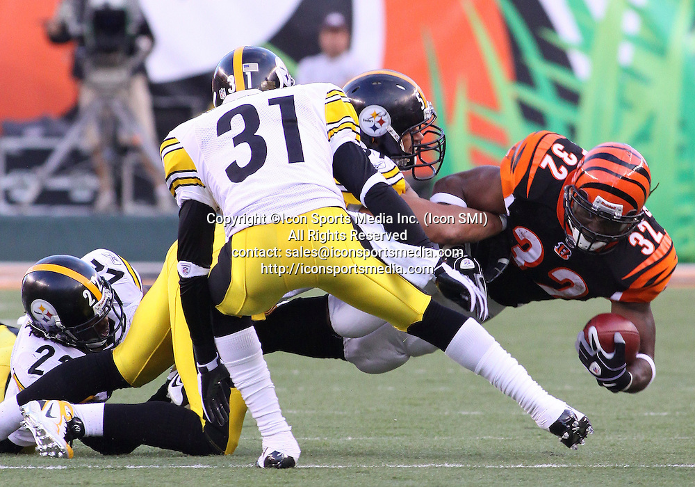 September 27 2009: RB Cedric Benson (32) of the Cincinnati Bengals dives forward for extra yards during a game against the Pittsburgh Steelers at Paul Brown Stadium in Cincinnati, OH.