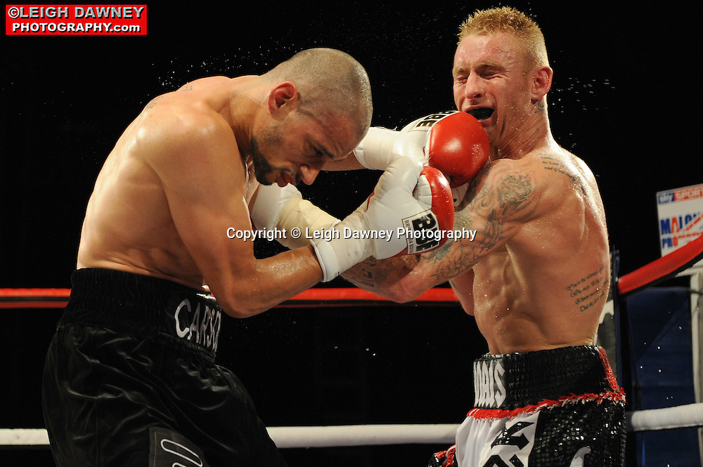 Curtis Woodhouse (black shorts) defeats Stefy Bull at the Doncaster Dome, Doncaster on 2nd July 2010. Frank Maloney Promotions. Photo credit: © Leigh Dawney
