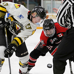 TRENTON, ON  - MAY 5,  2017: Canadian Junior Hockey League, Central Canadian Jr. &quot;A&quot; Championship. The Dudley Hewitt Cup. Game 7 between he Georgetown Raiders and The Powassan Voodoos.  Parker Bowman #17 of the Powassan Voodoos and Louis Kereakou #81 of the Georgetown Raiders during the face-off in the second period <br /> (Photo by Amy Deroche / OJHL Images)
