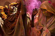 Widows from ashrams around Vrindavan play with color during a Holi celebration event at the Gopinath Temple in Vrindavan, India, March 21, 2016. The event was organized by Sulabh International, which has been striving to bring widows back to society's mainstream - traditionally, it is taboo for widows to celebrate holidays. (photo by Amy Toensing)