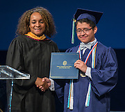 Houston ISD board president Rhonda Skillern-Jones presents commendations during the first ever graduation for Mickey Leland College Preparatory Academy, May 27, 2015.
