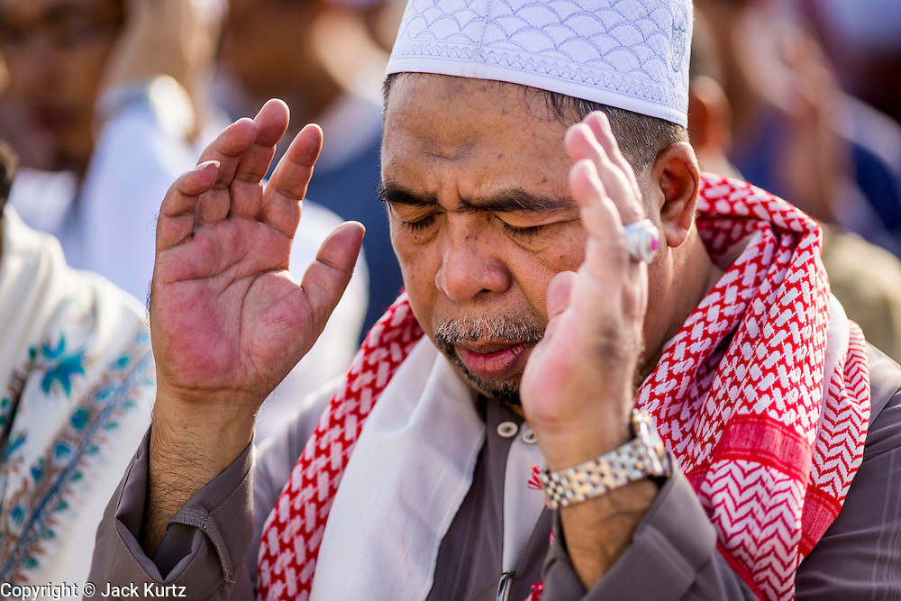 A man prays during Eid services at Songkhla Central Mosque in Songkhla province of Thailand. Eid al-Fitr is also called Feast of Breaking the Fast, the Sugar Feast, Bayram (Bajram), the Sweet Festival and the Lesser Eid, is an important Muslim holiday that marks the end of Ramadan, the Islamic holy month of fasting.
