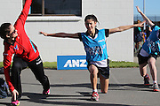Sofia Fenwick of the Tactix during a warm up drill with Paris Dyer, 13 of the Southbridge Netball Club during the ANZ Championship Roadshow, Win a Warmup, held at the Selwyn Netball Centre, Lincoln. 17 May 2014 Photo: Joseph Johnson/www.photosport.co.nz