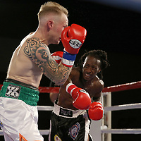 Leonardo Kenon lands the knock out punch to the nose of Tommy Bryant during a Fire Fist Boxing Promotions boxing match at the A La Carte Pavilion on Saturday, August 12 , 2017 in Tampa, Florida.  (Alex Menendez via AP)