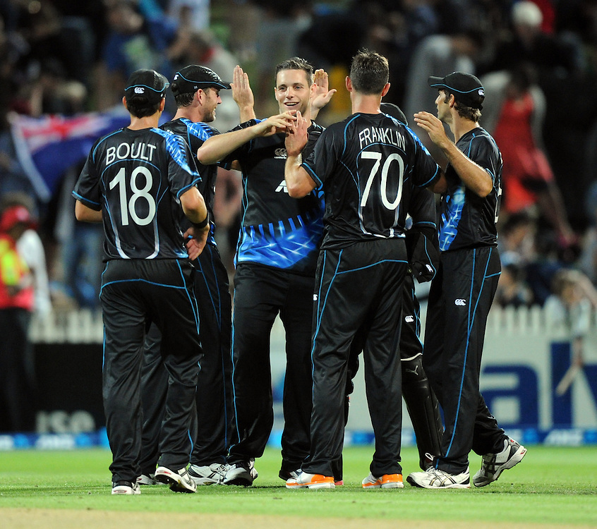 New Zealand's Mitchell McClenaghan, centre, celebrates the final catch and the win over England by 55 runs in the Twenty 20 cricket match at Seddon Park, Hamilton, New Zealand, Tuesday, February 12, 2013. Credit:SNPA / Ross Setford