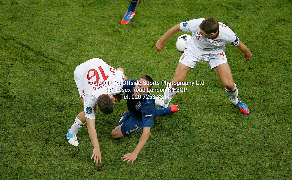 11/06/2012 European football championships. France v England.<br /> James Milner makes a painful tackle on Franck Ribery.<br /> Photo: Mark Leech.