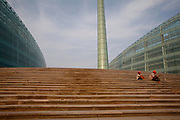 Zhengzhou, Henai, CHN, September 9th 2007:  The new city of Zhengzhou have 200.000 new apartments, a new conference center and a fine arts center in anticipitation of a booming future. Construction workers putting a finishing touch on the stairs to the Arts Center.