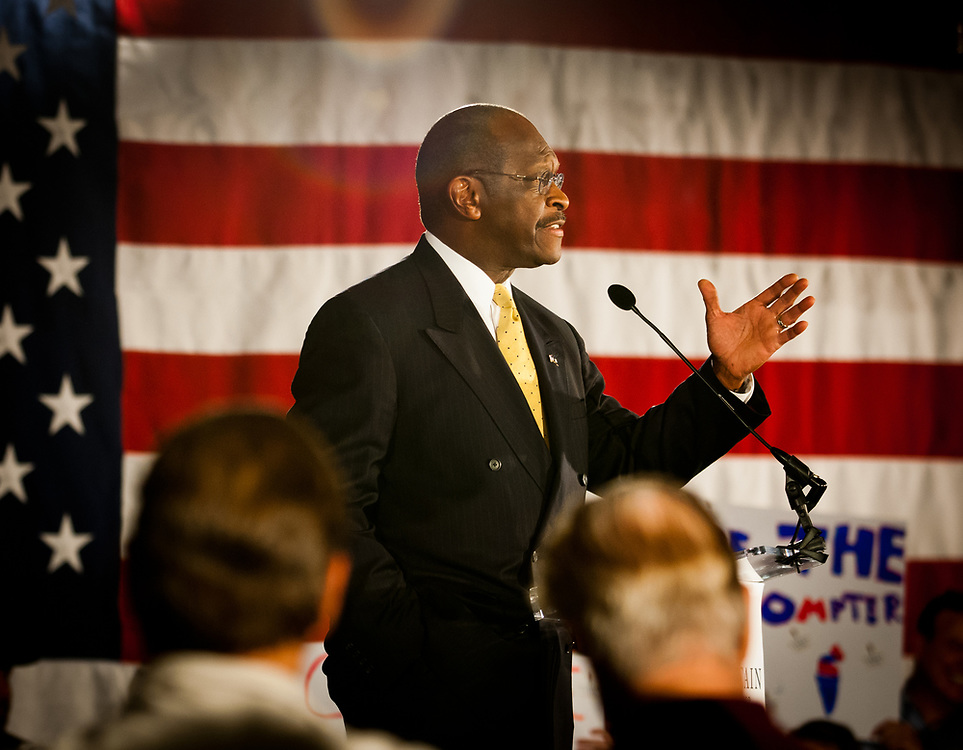 Presidential hopeful Herman Cain speaks during a campaign Rally in the Radisson Hotel in Nashua, NH.