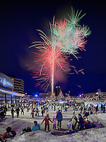Fire on Ice, the annual New Year's Eve celebration hosted by the Anchorage Downtown Partnership and the IBEW, is a popular event. This combination photograph features the skating party at town square which is immediatley followed by a spectacular year-ending fireworks display.