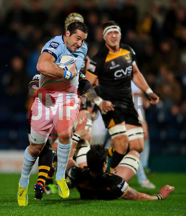 Bayonne Full Back (#15) Scott Spedding  is tackled by Wasps Winger (#14) Christian Wade  (unseen) during the first half of the match - Photo mandatory by-line: Rogan Thomson/JMP - Tel: 07966 386802 - 17/10/2013 - SPORT - RUGBY UNION - Adams Park Stadium, High Wycombe - London Wasps v Bayonne - Amlin Challenge Cup Round 2.