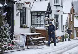 © Licensed to London News Pictures. 27/12/2017. Dorking, UK. Residents of Coldharbour brave the snow showers and low temperatures to visit the village shop - in the Surrey Hills. Photo credit: Peter Macdiarmid/LNP
