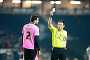 Northampton Town Defender Brendan Maloney gets a yellow card during the The FA Cup Third Round Replay match between Milton Keynes Dons and Northampton Town at stadium:mk, Milton Keynes, England on 19 January 2016. Photo by Dennis Goodwin.