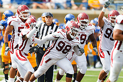 September 24, 2011; San Jose, CA, USA; New Mexico State Aggies defensive tackle David Mahoney (98) is congratulated by teammates after recovering a fumble against the San Jose State Spartans during the second quarter at Spartan Stadium.