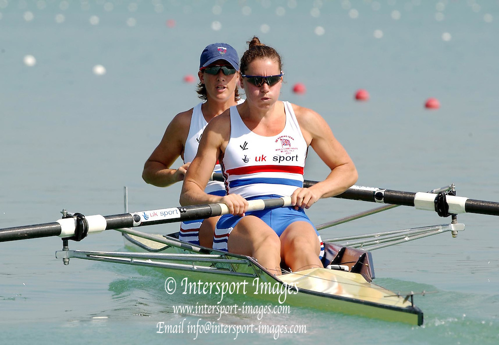 26/08/2003 Tuesday.2003 World Rowing Championships, Milan, Italy.GB's Katherine Grainger and Cath Bishop [right], move of the pontoon at the start of the women's pair repechage, going on to win and qualify for the semi final on  Idro Scala rowing course, Milan,  on the third day of the World Rowing Championships... Milan. ITALY 2003 World Rowing Championships. Idro Scala Rowing Course. [Mandatory Credit: Peter Spurrier: Intersport Images.]