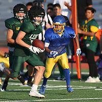 (Photograph by Bill Gerth/ for SVCN/8/18/17)  Leigh RB Mason Peterson goes for a big gain at the BVAL Football Jamboree at Leigh High School, San Jose CA on 8/18/17.