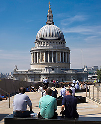 © Licensed to London News Pictures.<br /> 18th July 2014.LONDON UK<br /> London Bakes in The  Sun.<br /> Temperatures reached 34 degrees in London today,  as city workers enjoyed a roof top lunch over looking St Paul's Cathedral.  Photo credit : Andrew Baker/LNP