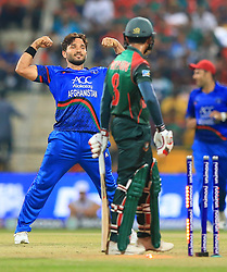 September 20, 2018 - Abu Dhabi, United Arab Emirates - Afghanistan cricketer Gulbadin Naib celebrates after taking a wicket during the 6th cricket match of Asia Cup 2018 between Bangladesh and Afghanistan at the Sheikh Zayed Stadium,Abu Dhabi, United Arab Emirates on September 20, 2018. (Credit Image: © Tharaka Basnayaka/NurPhoto/ZUMA Press)