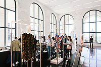"""ROME, ITALY - 15 OCTOBER 2018: Visitors are seen here by the FENDI Haute Coutures dresses during the LVMH Journées Particulières exhibition at the Fendi headquarters in Rome, Italy, on October 15th 2018.<br /> <br /> The LVMH Journées Particulières is is a series of exhibitions that show the creations and history of the LVMH fashion houses. The driving theme behind the Journées Particulières is to allow the general public to discover the inner workings of the Houses which are part of the LVMH heritage.The LVMH Journées Particulières exhibition by fashion house FENDI takes place at their headquarters at the Palazzo della Civiltà Italiana, also called the """"Colosseo Quadrato"""" (Square Colosseum),  an outstanding jewel of the 20th century Roman architecture."""