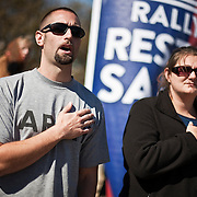 Ryan, a former U.S. Soldier and an Iraq Veteran, sings the national anthem with his wife, Tiffany, at the Rally to Restore Sanity and/or Fear on the National Mall in Washington, D.C. on Saturday, October 30th, 2010...(Samuel Corum for TBD)