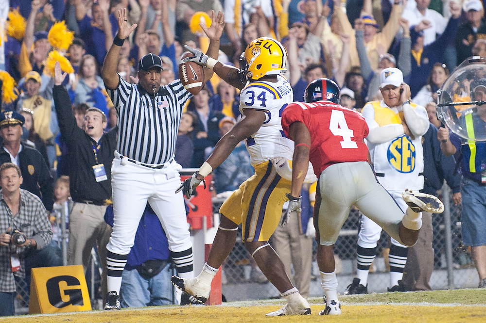 LSU Tigers running back Stevan Ridley (34) runs in for a touchdown during the second half  of the football game. LSU Tigers defeated Mississippi Rebels 43-36.