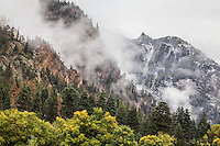 Storm clouds drift through the San Juan Mountains during an autumn storm.  Near Ouray, Colorado.