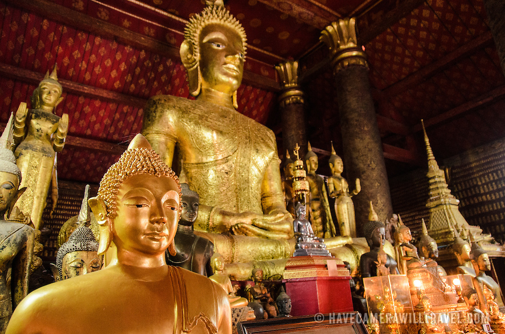 The ornate gold statues of Buddha at Wat Mai Suwannaphumaham.  Wat Mai, as it is often known, is a Buddhist temple in Luang Prabang, Laos, located near the Royal Palace Museum. It was built in the 18th century and is one of the most richly decorated Wats in Luang Prabang.