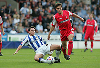 Photo: Paul Thomas.<br /> Huddersfield Town v Swindon Town. Coca Cola League 1. 29/10/2005. <br /> <br /> Swindon's Stefani Miglioranzi beats of a tackle from Mark Hudson.