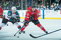 KELOWNA, CANADA - APRIL 8: Kyle Topping #24 of the Kelowna Rockets back checks Joachim Blichfeld #20 of the Portland Winterhawks as he skates with the puck on April 8, 2017 at Prospera Place in Kelowna, British Columbia, Canada.  (Photo by Marissa Baecker/Shoot the Breeze)  *** Local Caption ***