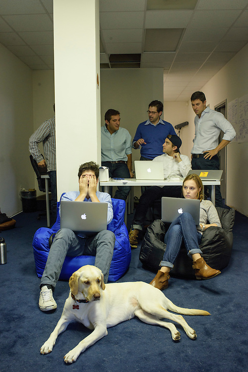 Alexandria, Virginia - October 16, 2014: Independent Journal Review contributors and editors (and dogs) sit in during the &quot;Daily brainstorm sesh,&quot; as editor-in-chief Bubba Atkinson, not in frame, calls the gathering on the second floor of the IJReview offices in Alexandria, Virginia Thursday October 16, 2014. Charlie (female), Bubba's dog is in the foreground. Colin Chocola, original content creator, left, and Nicole Higman, managing editor of Liftbump, right, are in the second row. In the third row (L-R) Carl Sceusa, head of technology, partially obscured, Anton Vuljaj, chief revenu officer, Matt Manda, communications director, Rob Groulx, motion director, sitting, and co-founder Alex Skatell.<br /> <br /> IJReview is a conservative newssite that is gaining steam online.<br /> <br /> <br /> CREDIT: Matt Roth for The New York Times<br /> Assignment ID: 30165484A