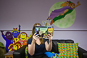 A women sitting in the visitors family room at HMP Holloway, the main womens prison in London.