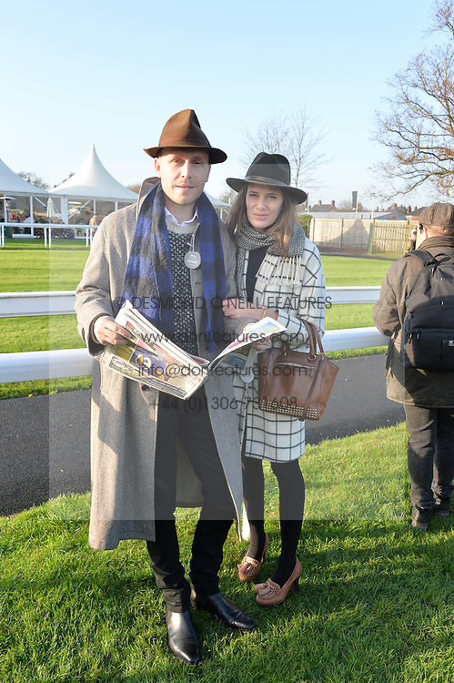 MR HUDSON and HOLLY GRACE at the 2014 Hennessy Gold Cup at Newbury Racecourse, Newbury, Berkshire on 29th November 2014.  The Gold Cup was won by Many Clouds ridden by Leighton Aspell.