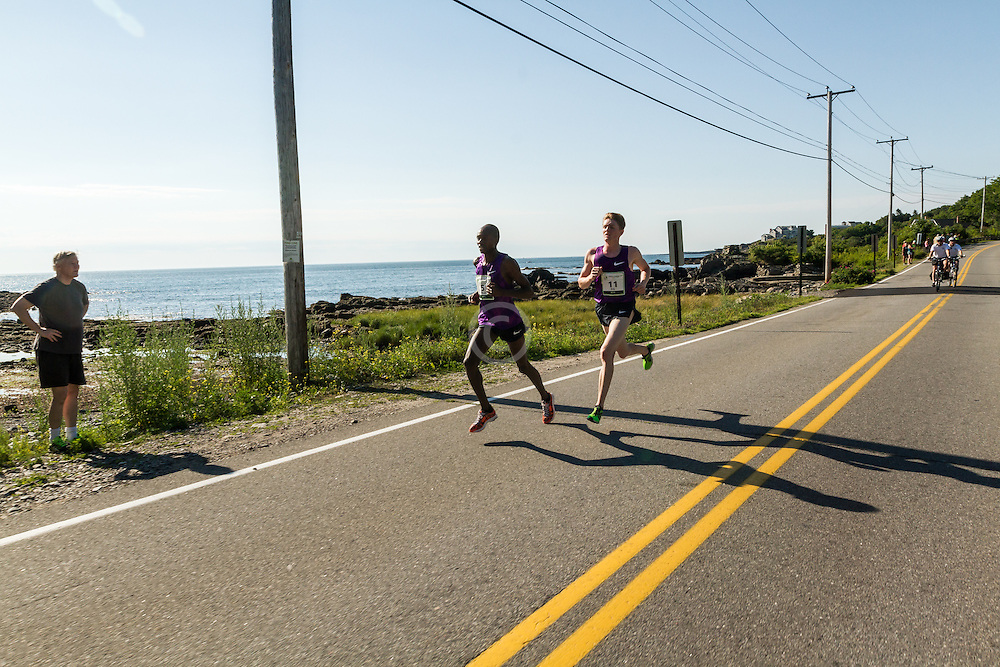 Micah Kogo, Eric Jenkins pass Pond Cove near mile 5