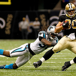 January 1, 2012; New Orleans, LA, USA; Carolina Panthers safety Charles Godfrey (30) hits New Orleans Saints tight end Jimmy Graham (80) after a catch during the third quarter of a game at the Mercedes-Benz Superdome. Mandatory Credit: Derick E. Hingle-USA TODAY SPORTS