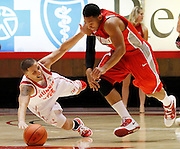 Utah guard Chris Kupets (2) falls to the court after having the ball stolen away by New Mexico guard Dairese Gary (5) during the second half of an NCAA college basketball game, Wednesday, Jan. 19, 2011, in Salt Lake City, Utah. Utah defeated New Mexico 82-72. (AP Photo/Colin E Braley)
