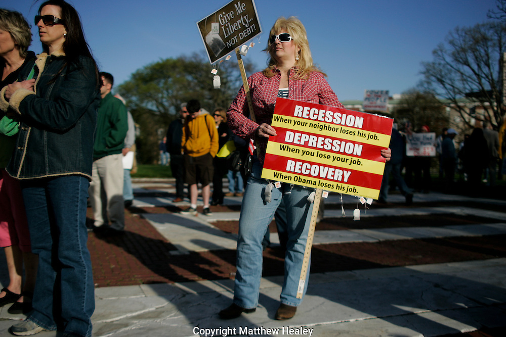 Laurie Gibbs of Wakefield, Rhode Island listens to a speaker during a Tea Party rally in front of the Rhode Island State House in Providence, Rhode Island on April 15. 2010.  Photo by Matthew Healey