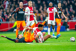 Lisandro Martínez #21 of Ajax and Sam Lammers #14 of PSV Eindhoven in action during the match between Ajax and PSV at Johan Cruyff Arena on February 02, 2020 in Amsterdam, Netherlands