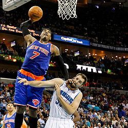 November 20, 2012; New Orleans, LA, USA; New York Knicks small forward Carmelo Anthony (7) dunks over New Orleans Hornets power forward Ryan Anderson (33) during the first half of a game at the New Orleans Arena. Mandatory Credit: Derick E. Hingle-USA TODAY SPORTS