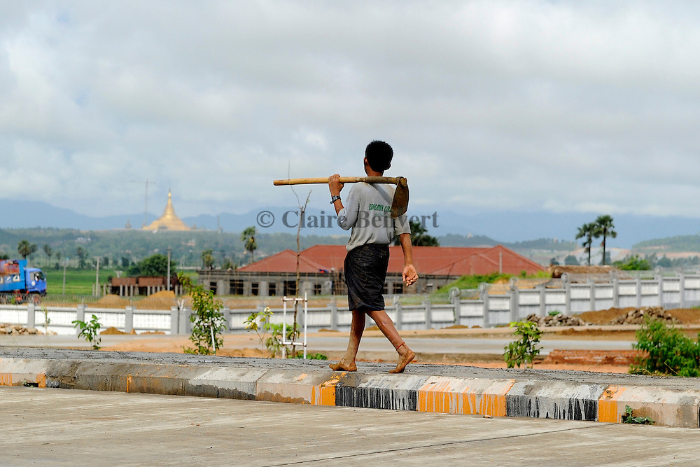 Young boy on the way to work in Naypyidaw city.